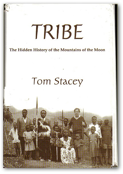 Book Cover: Tom Stacey in 1963  just across the border in Congo from Uganda flanked by the rebel Bakonzo  leadership of those days.  Among the group is the 10-year-old Charles Wesley Mumbere, today's King of Rwenzururu.""