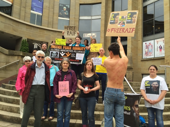 Vigil attendees call for release of Raif Badawi