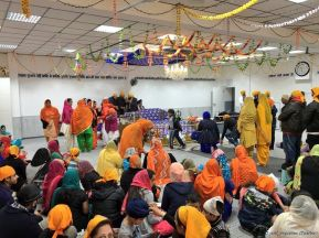 People gathering at Gurdwara Nanaksar Satsang Darbar in Essen, Germany. The Sikh temple had been hit by a terrorist bomb attack a week earlier.
